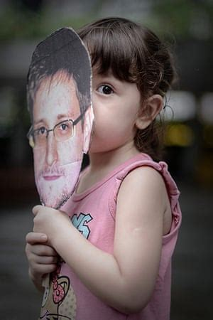 Edward Snowden supporters march in Hong Kong – in pictures